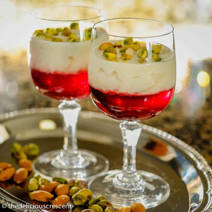 Rice custard with pomegranate jelly in a serving cup.