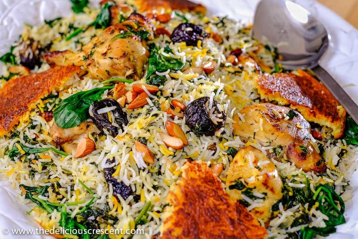 Saffron Yogurt Rice with Spinach and Prunes, a classic Persian dish referred to as Tahchin e Esfanaj.