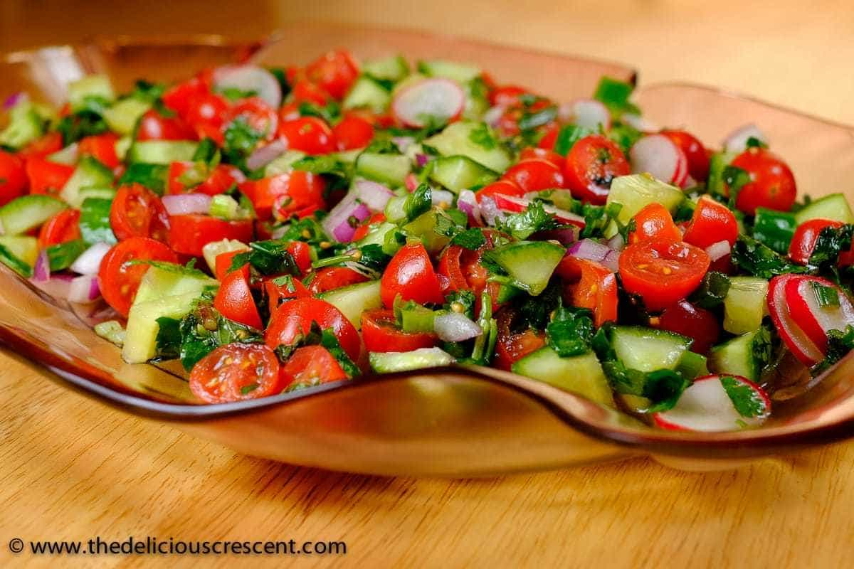 Persian Tomato Cucumber Salad served on a plate