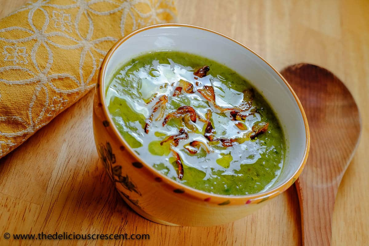 A side angle photo of the creamy leek avocado soup.