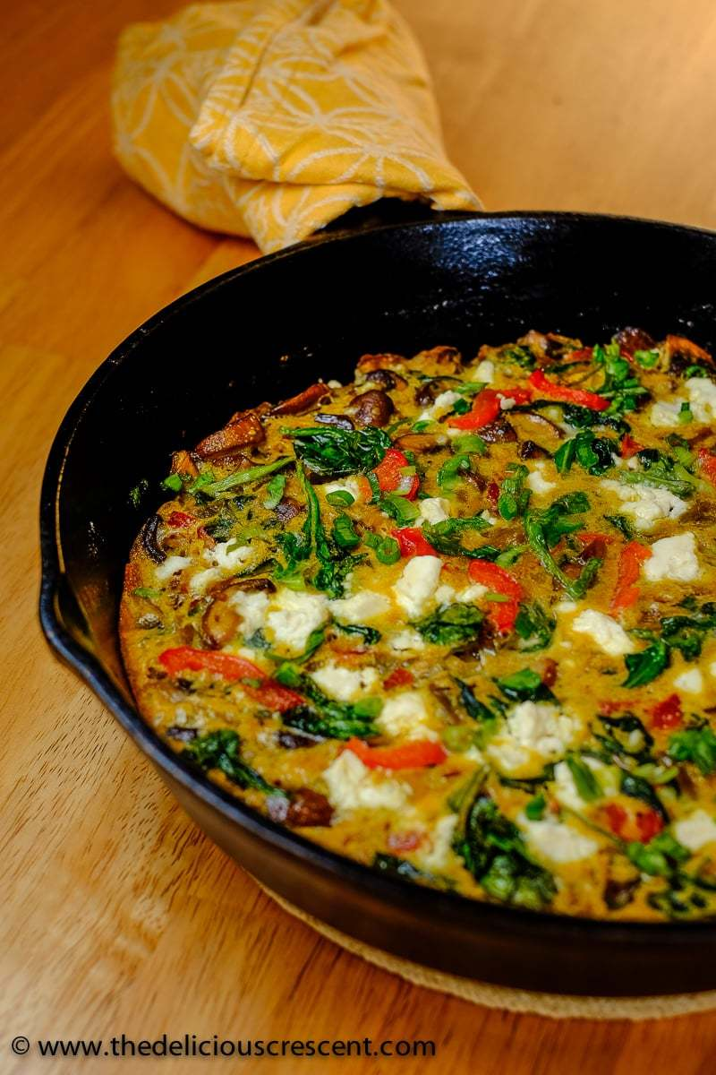Mushroom Spinach Red Pepper KuKu in a skillet