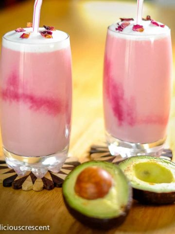 Rose flavored Moroccan avocado smoothie served in two glasses.