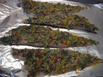 Almond and herb mixture spread on the fish for making the baked fish.