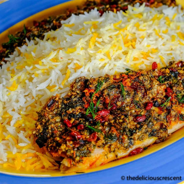 Almond crusted baked fish served with rice.