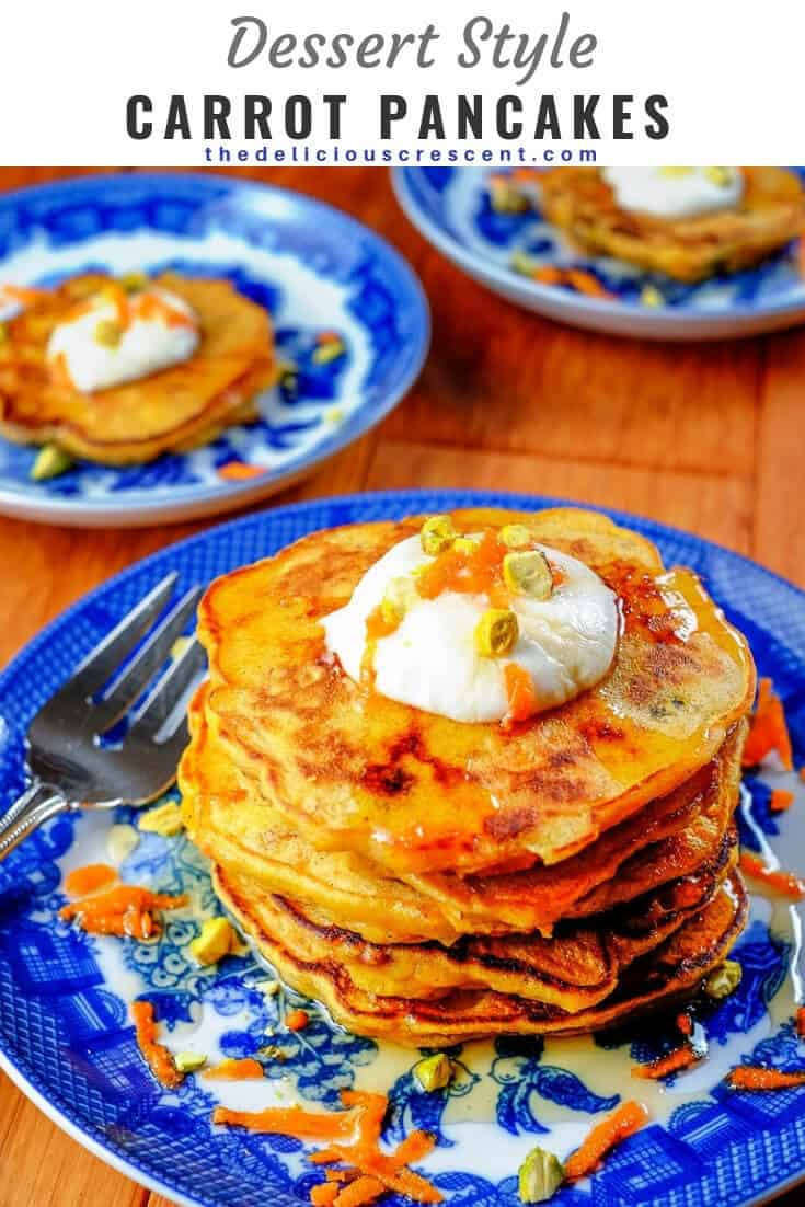 Dessert style cardamom scented carrot pancakes are a healthy treat for your morning weekend breakfast. It is an easy recipe with a delightful blend of spices, almonds or cashews, raisins to please your kids and family. Serve it with an amazing rose water (may substitute) flavored ricotta cream made with Greek yogurt for that extra protein. No need of any maple syrup or sweets for your brunch with this freezermeal! #carrot #pancakes