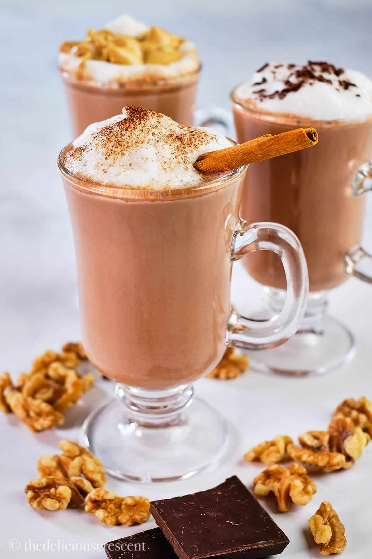 Healthy hot cocoa topped with milk foam and cinnamon stick.