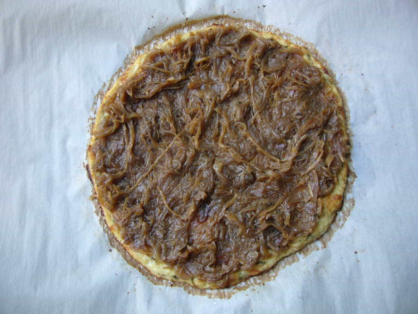 French onion sauce spread on the cauliflower crust for Low Carb French Onion Pizza