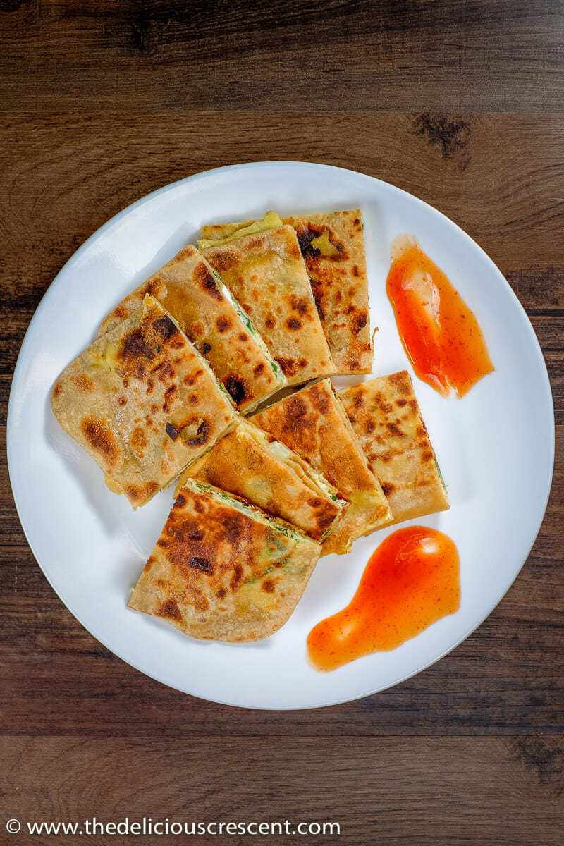 Best Egg Paratha Omelette Stuffed Flatbread The Delicious Crescent