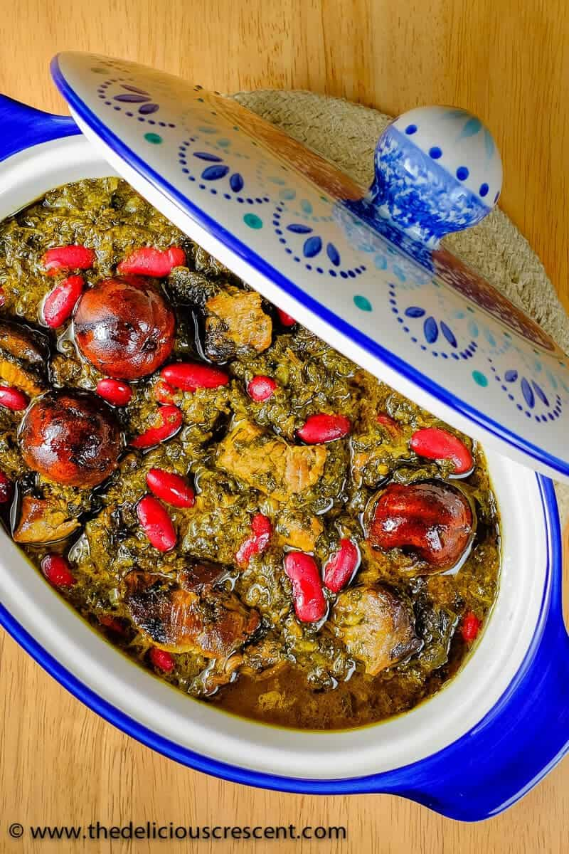 Ghormeh sabzi served in a blue and white serving dish.