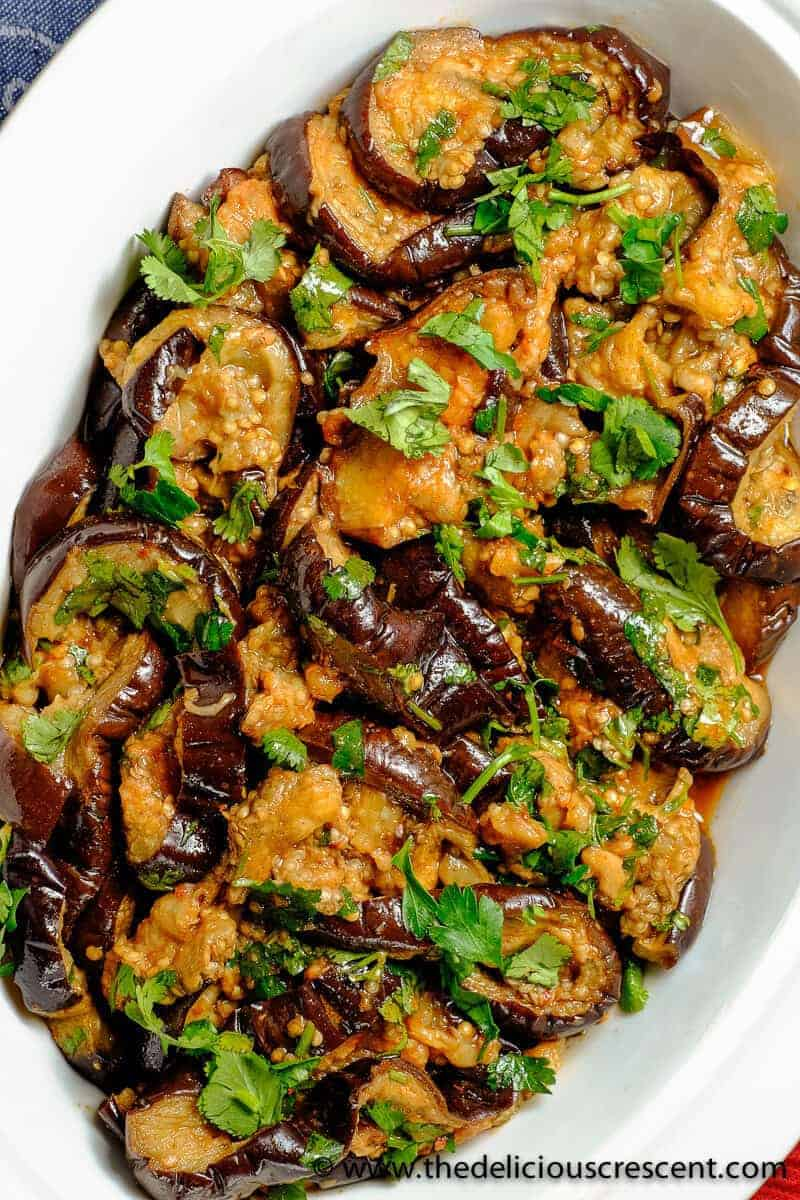 Moroccan eggplant salad smothered in chermoula is a stunningly lip smacking salad. It is low in calories and yet is a pretty good source of phytochemicals and other nutrients.