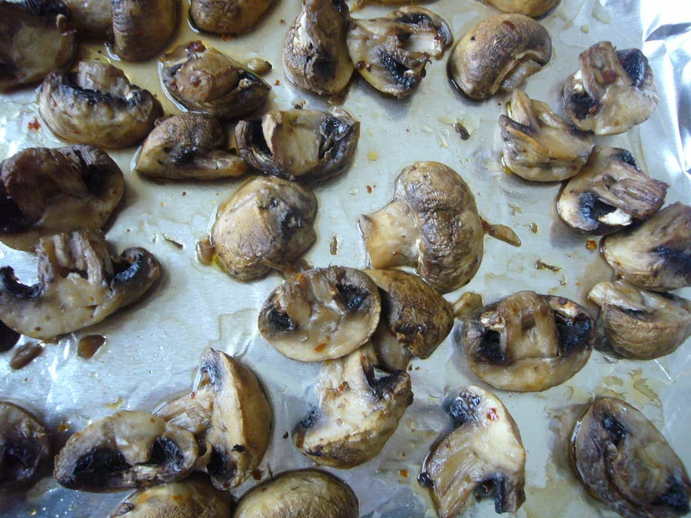 Roasted mushrooms on a baking sheet.