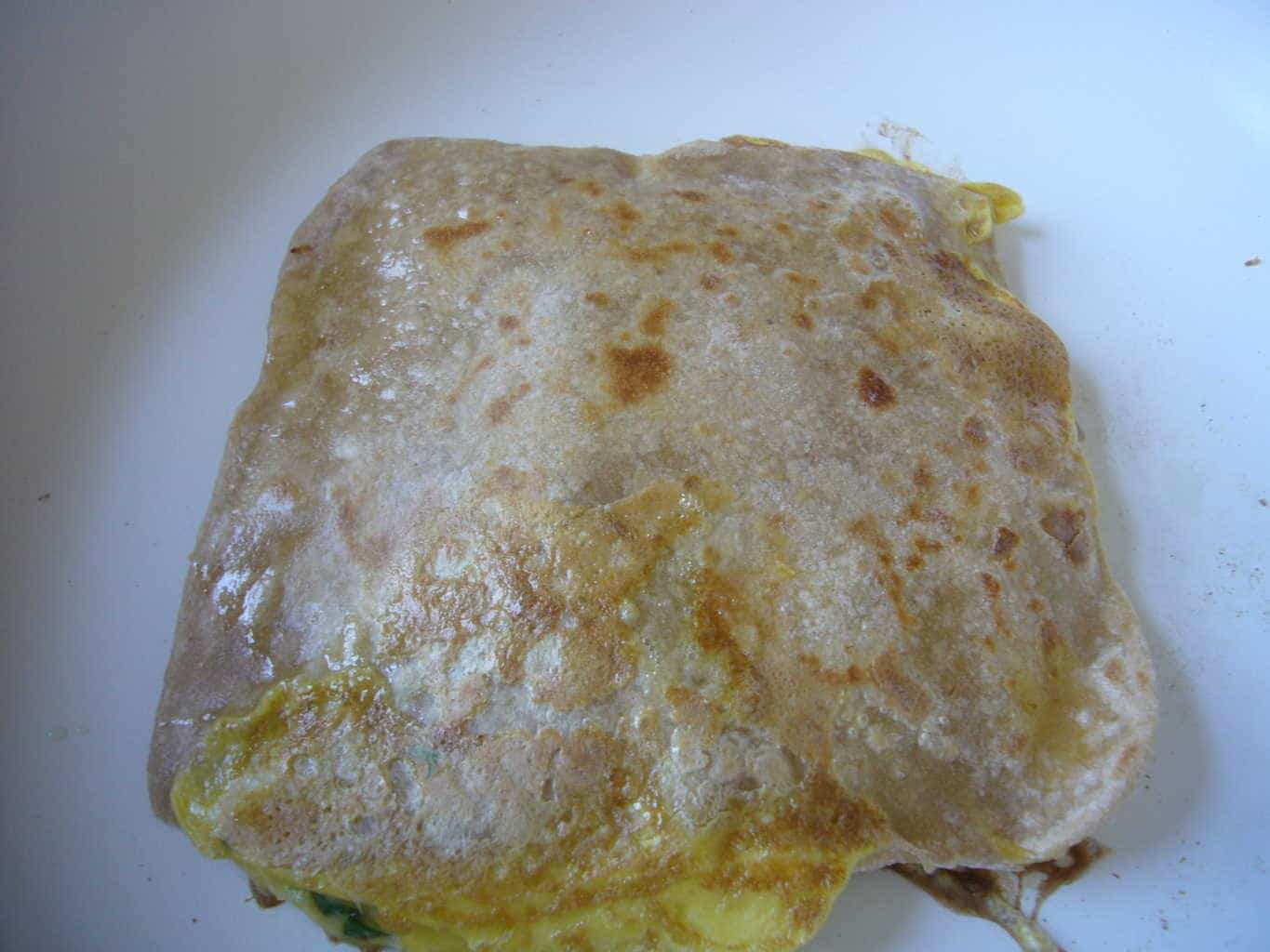 The omelette paratha after it has been cooked on both sides.