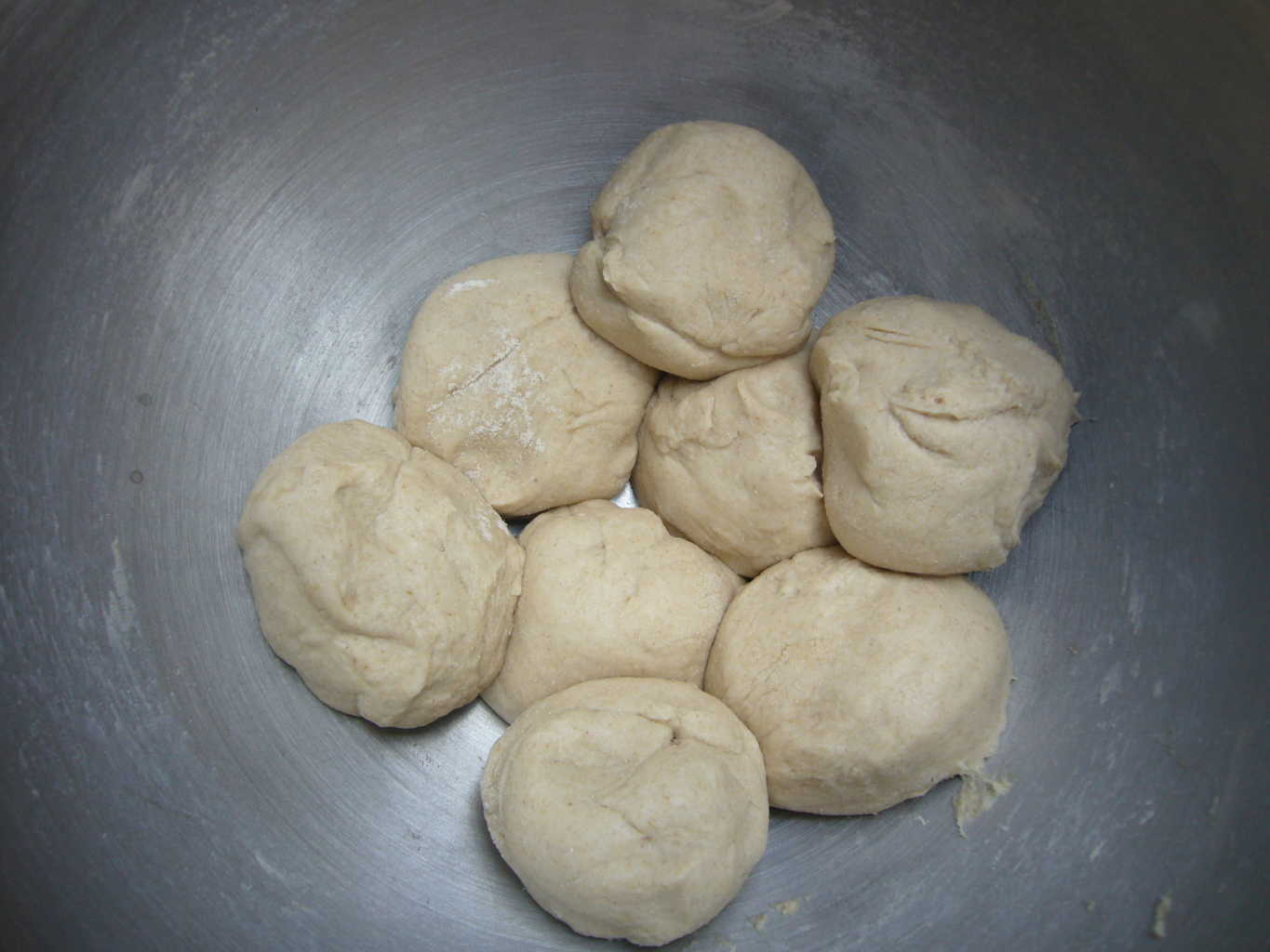 The dough is divided into portions to make the paratha.
