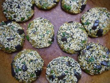 Eggplant chickpea patties with seeds on top.