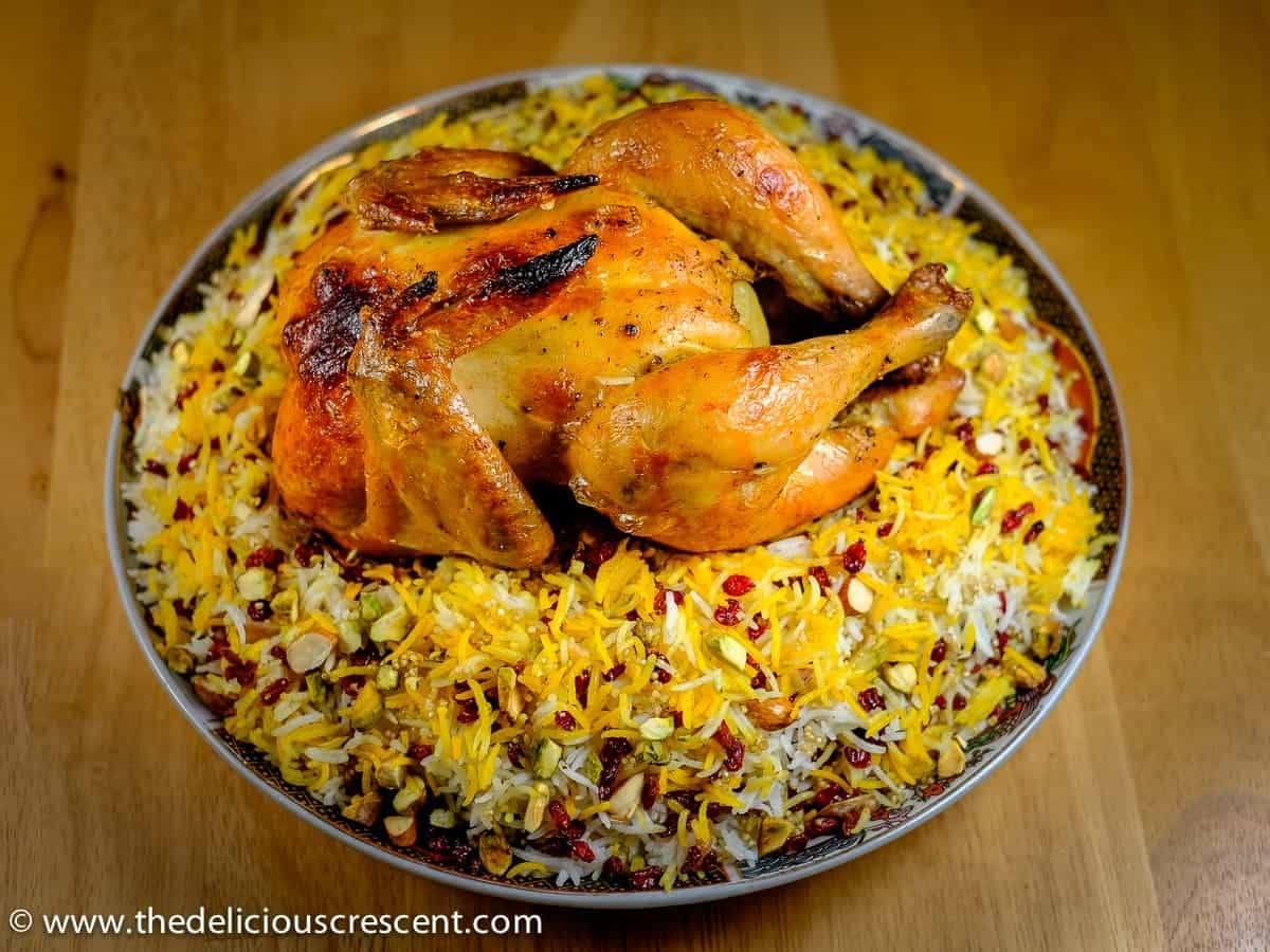 Barberry Quinoa Rice with Saffron Chicken is a tangy sweet mouth watering feast with plenty of protein, healthy fats and is phytochemical rich!! An adapted version of a popular Persian dish known as Zereskh Polow. This flavorful rice dish, studded with the super tasty barberries (Zereshk in Persian), quinoa, almonds and pistachios with the roasted chicken is a must try!