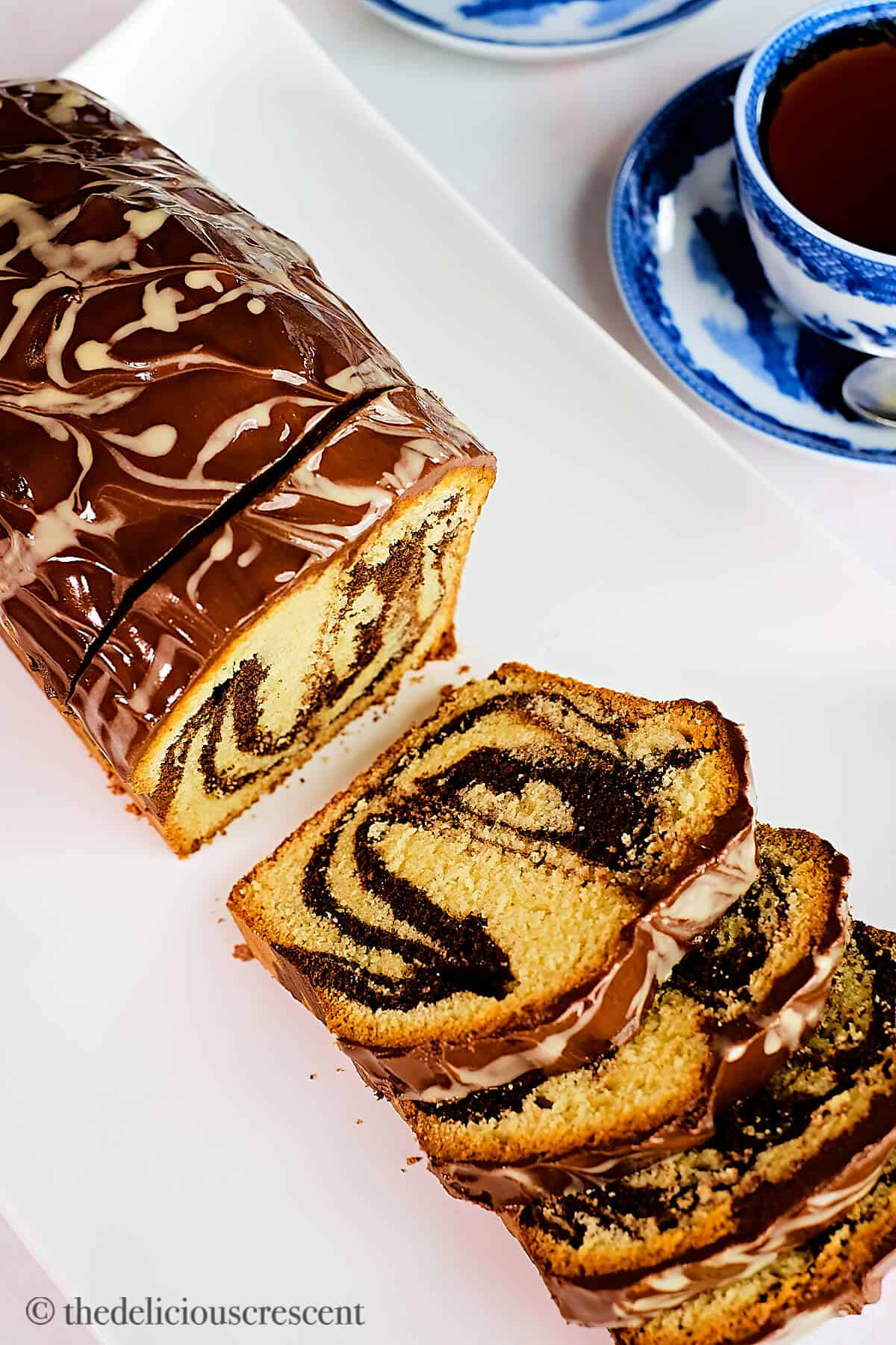 Overhead view of a loaf cake made with tahini and chocolate.