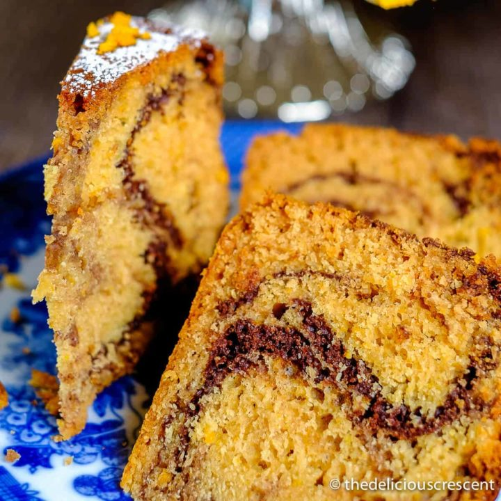Slices of marble tahini cake baked with chocolate and orange flavors served on a plate.