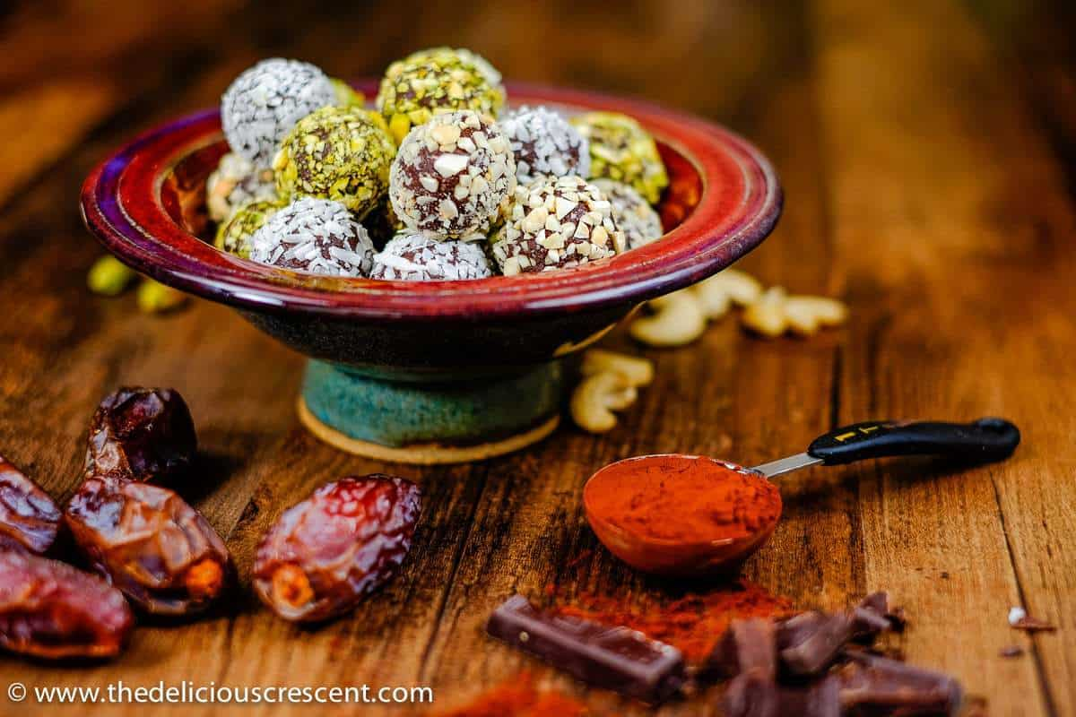 "Luscious Date Avocado Chocolate Truffles – a decadent, melt in the mouth treat, but with ""no"" heavy cream or butter, minimal added sugar and saturated fat. Prepared with ingredients that are good sources of phytochemicals, antioxidants, vitamins and minerals."