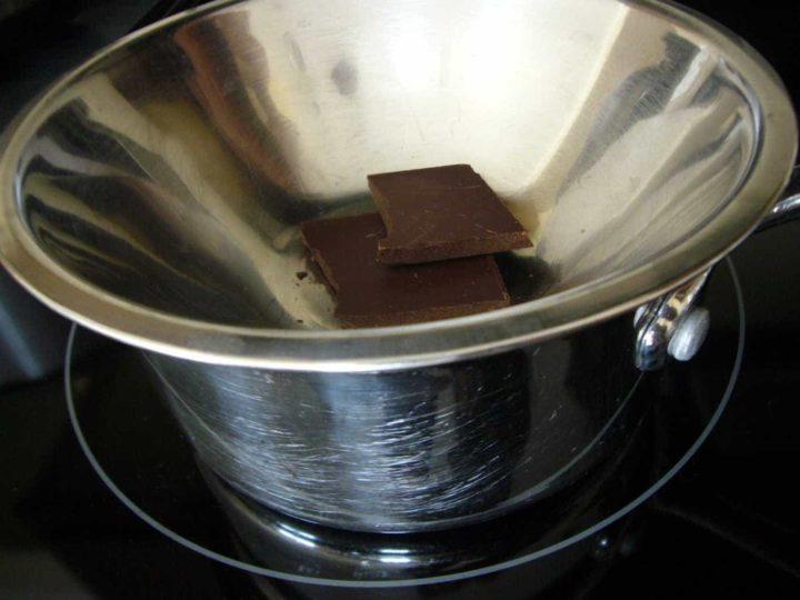 Melting chocolate for avocado chocolate truffles.