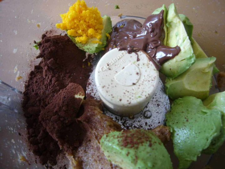 Placing all the ingredients in the food processor for avocado chocolate truffles.