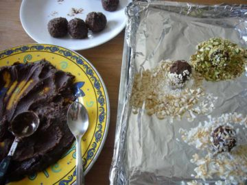 The smooth truffle balls rolled in coconut flakes and nuts.