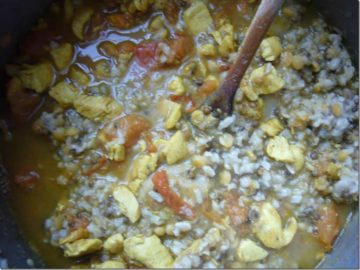 Chicken added to rice, lentils and spices.