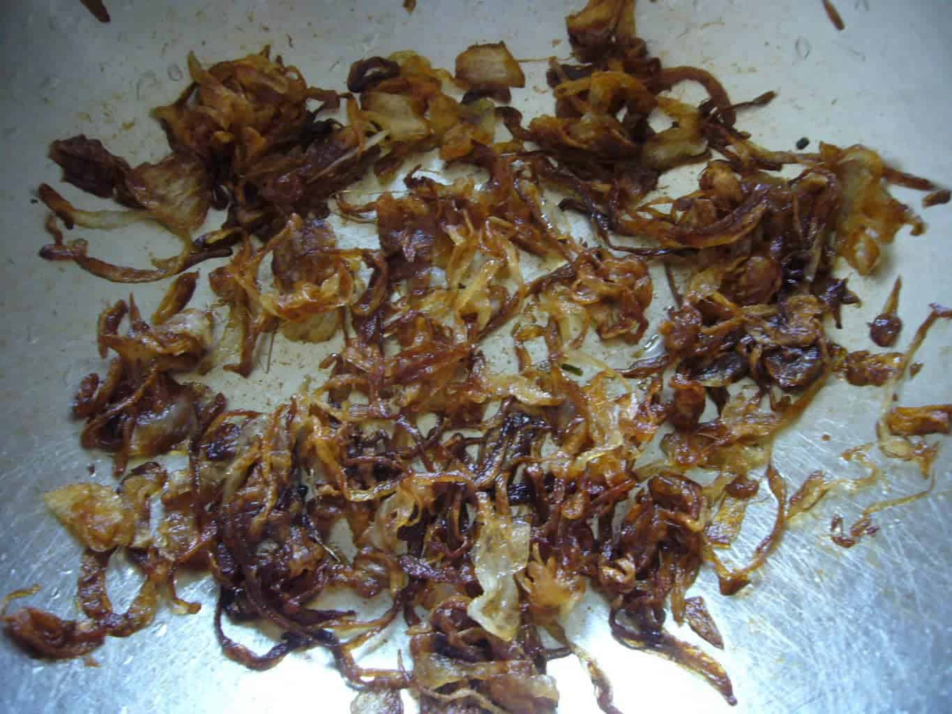 Onions nicely caramelized for making Persian soup.