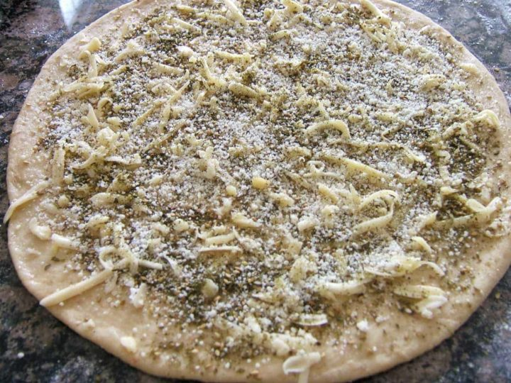 Dough topped with cheese and zaatar.