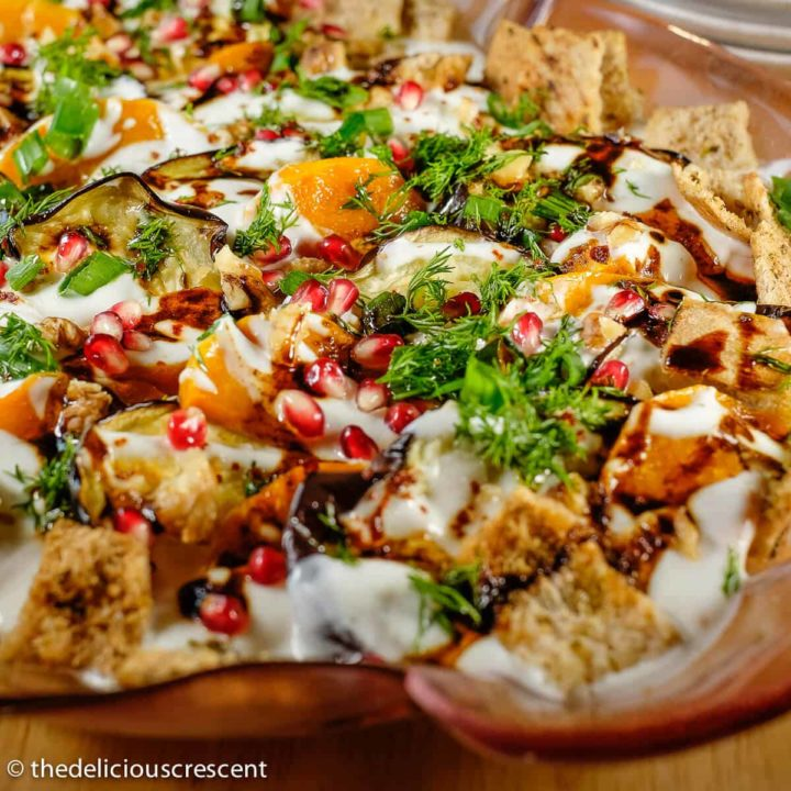 Eggplant yogurt salad (fatteh) served in a plate.