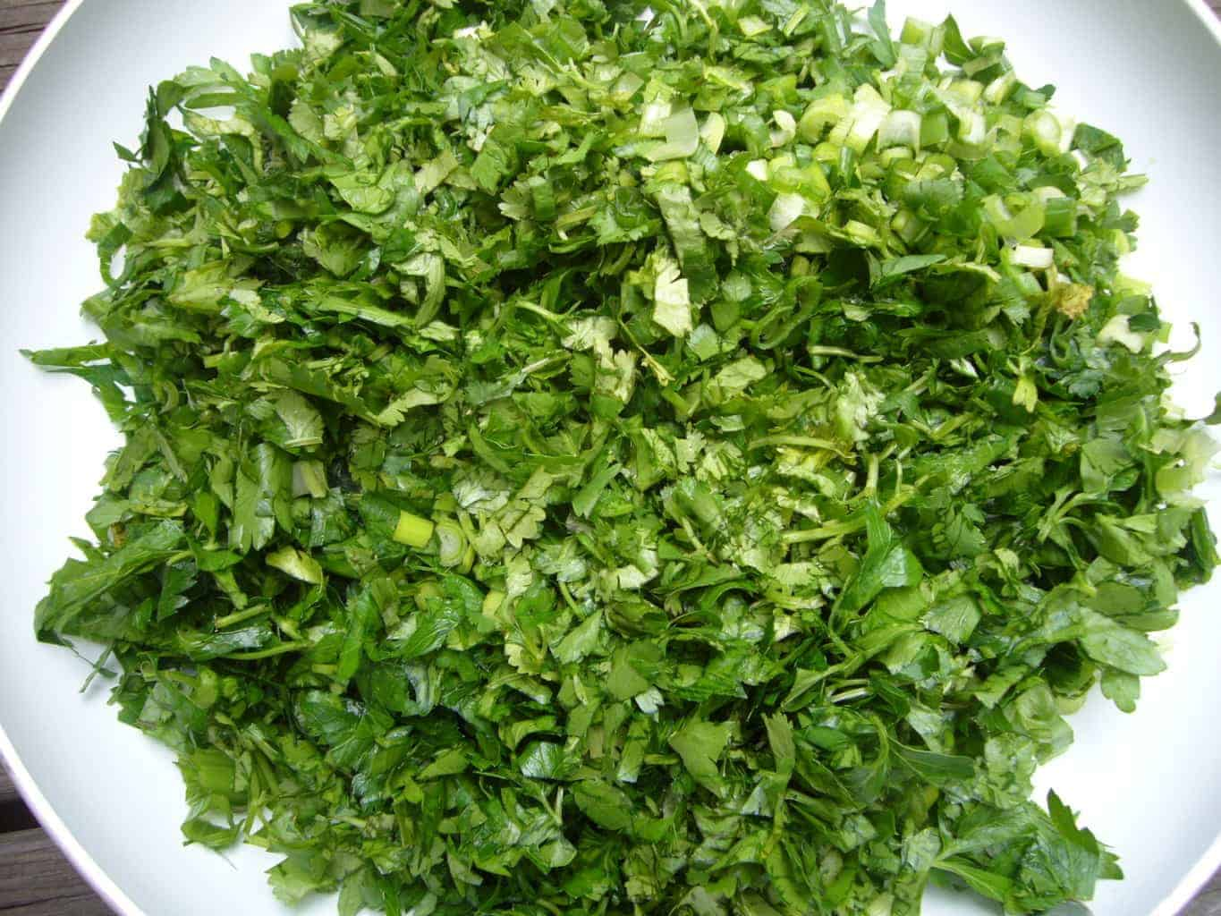 Mixture of fresh herbs for making ghormeh sabzi.