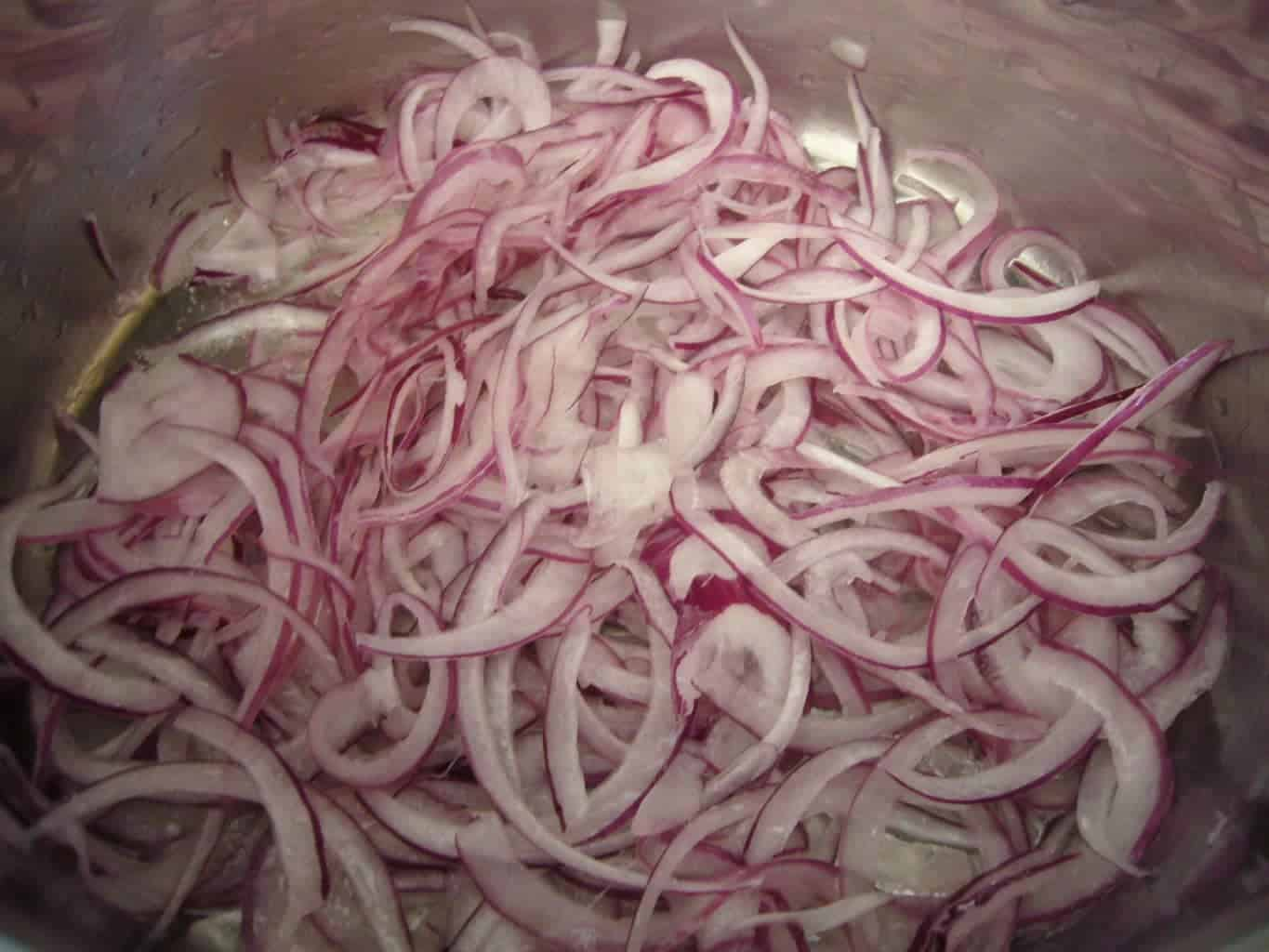 Onions thinly sliced for frying.