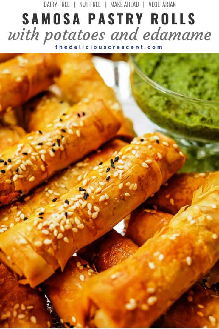 Samosa pastry rolls with potatoes and edamame are delicious savory party appetizers made with filo dough. This is an easier recipe for a healthier baked version of the traditional vegetarian Indian snack and so full of flavor. They are nut-free, dairy-free, freezer friendly, make ahead and bake to their crispy originality. Try this spicy snack with cilantro mint chutney or chili tomato sauce. #healthyrecipe #indianrecipe