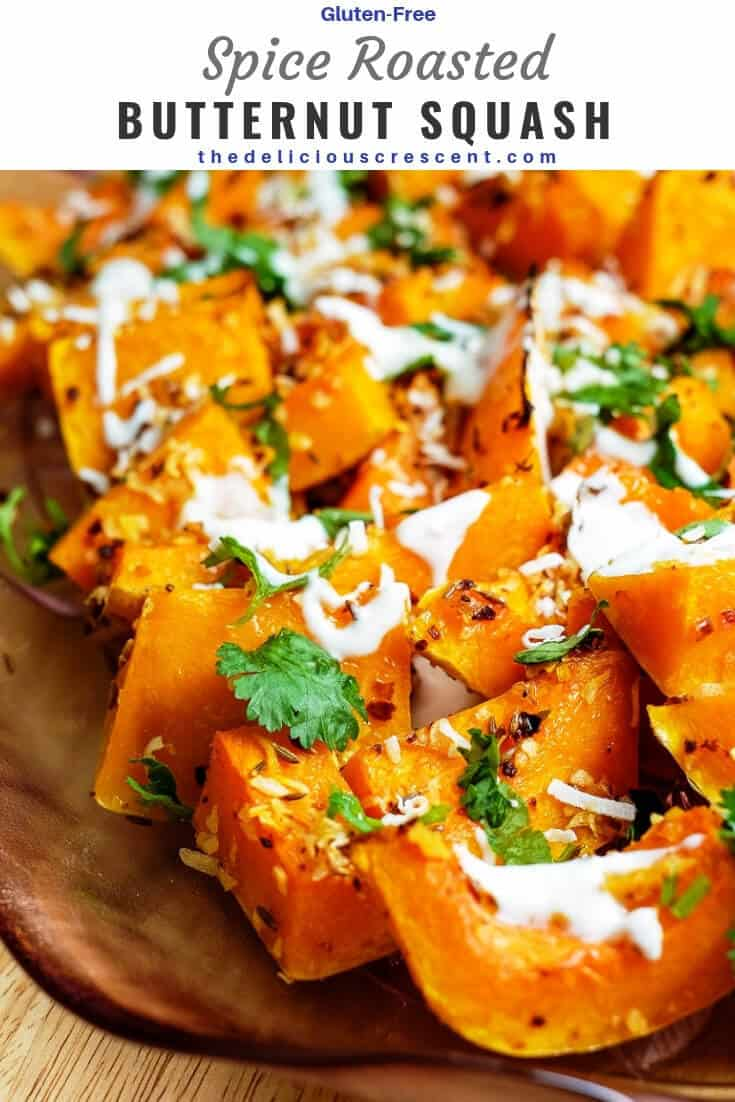 Roasted butternut squash with coconut, cumin and ginger is savory, gluten-free, perfectly tender, infused with flavorful spices and rich in nutrients! A delicious and spicy way to entertain or warm up in winter! This is a simple and easy recipe you can bake in the oven. Great for fall and the holidays. Vegan option. #butternutsquash #sidedish