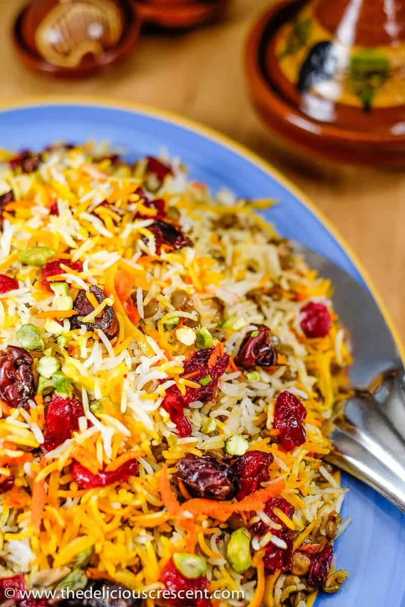 Lentil Cranberry Saffron Rice: A Persian style aromatic dish that is a bit tangy, subtly sweet and savory, packed with plant protein, fiber, antioxidants and healthy fats.
