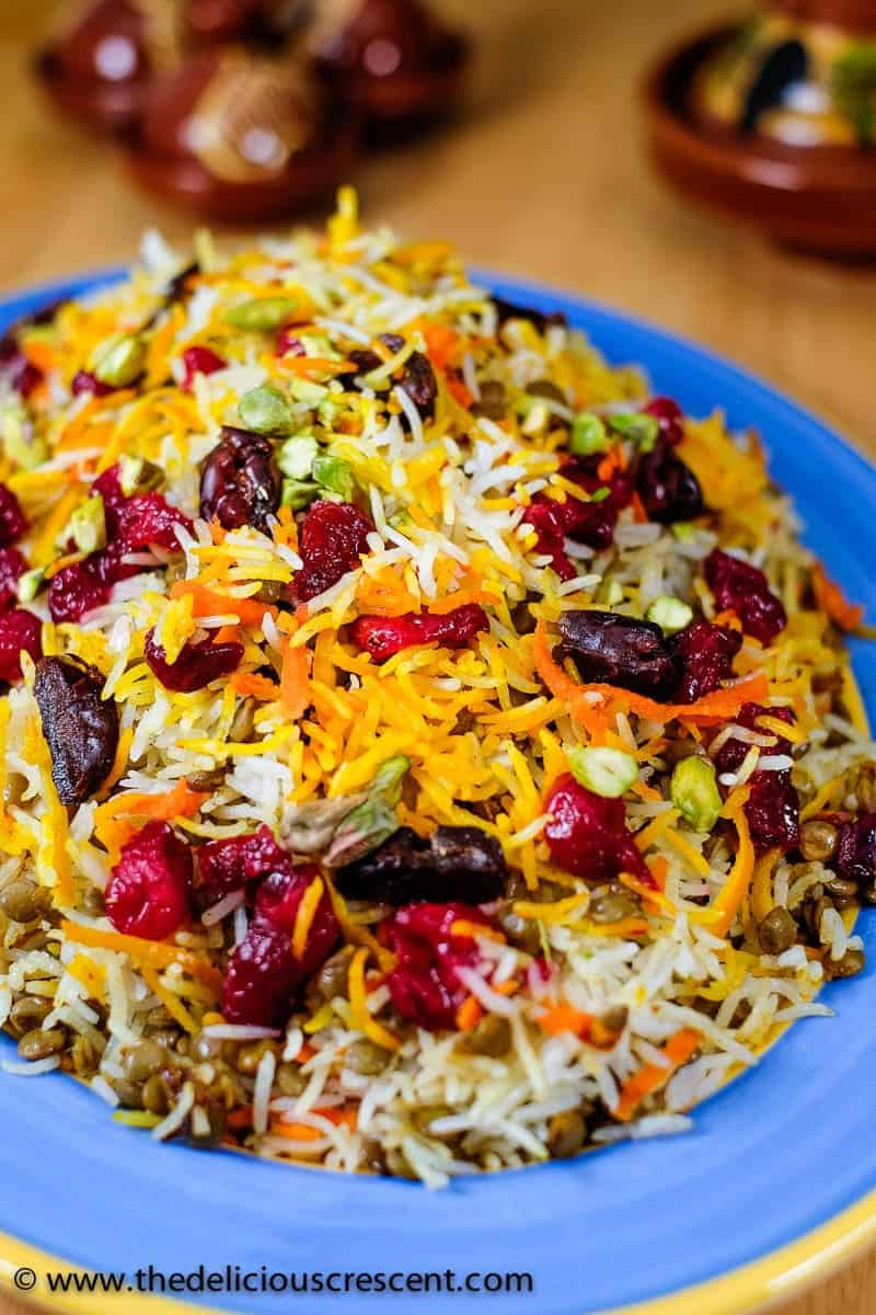 Lentils and rice with cranberries served on a plate and placed on a table