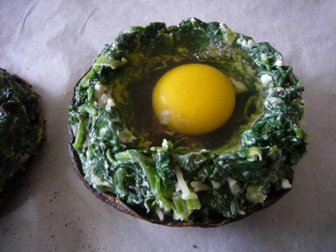 Cracked an egg into the portabello mushrooms with spinach around it.
