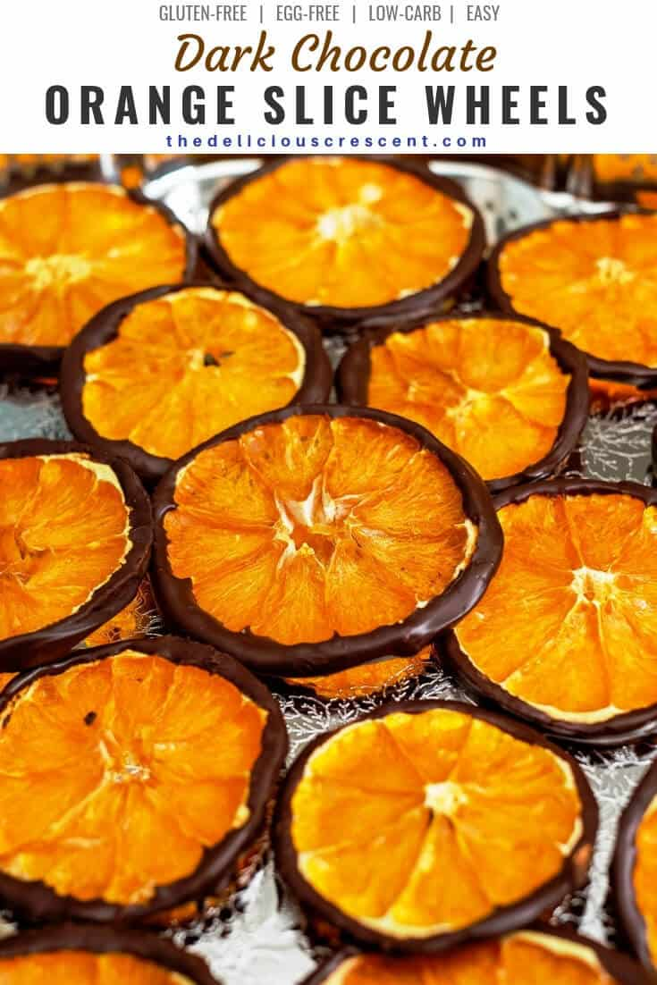 Dark chocolate orange slice wheels are a delicious tangy-sweet treat with decadence in every bite. This orange slice candy can make a great gift for the holidays. Learn how to make this easy recipe for these healthy snacks using orange slices dried at home. A quick treat with dried fruit and minimal added sugar. #lowcarb #sweets