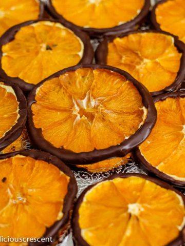 Dark chocolate orange slices arranged on a plate.
