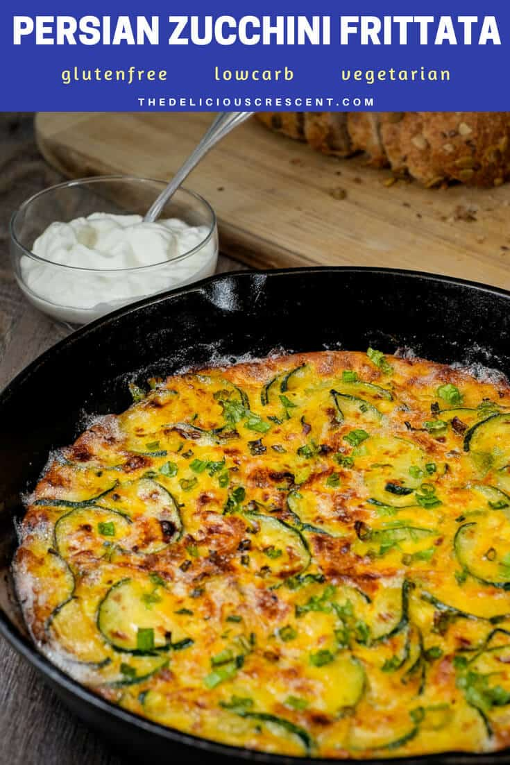 Persian zucchini frittata baked in a cast iron skillet and served with a dip.