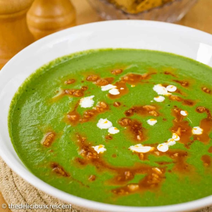 Creamy low carb spinach and mustard greens soup served in a bowl.