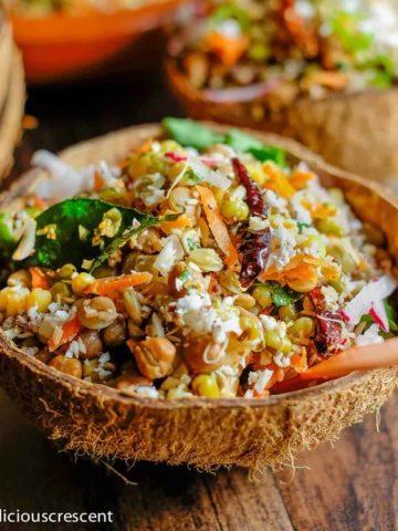 Sprouts salad served in a coconut shell.