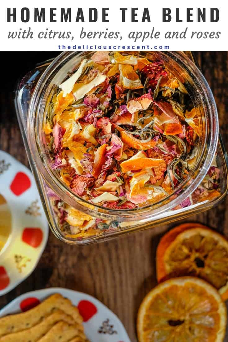 A view of homemade tea blend made with rose,citrus, berry, apple and stored in a glass jar.