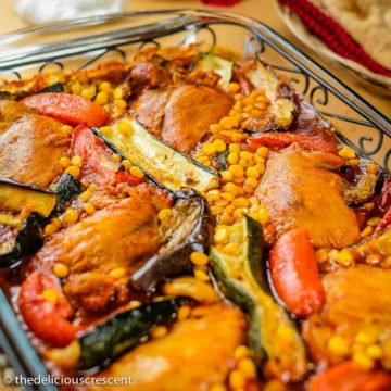 Zucchini stew with chicken (khoresht kadoo) served in a glass dish.