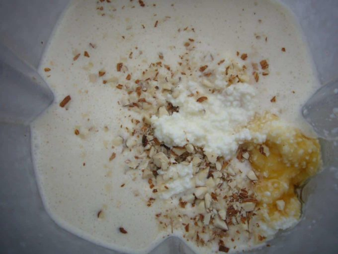 Add ricotta cheese to the badam malai kulfi mixture. May also add crushed almonds.