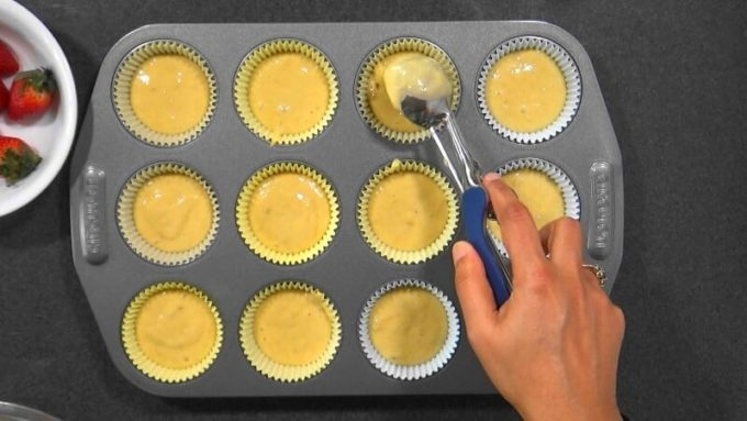 Filling the cupcake pan with the batter