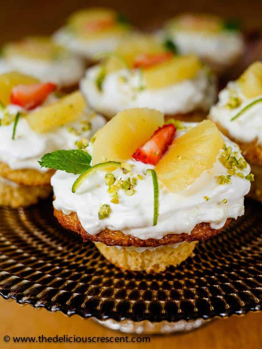 Pineapple cupcakes made with fresh cream and yogurt are decadently delicious. The thick yogurt lightens up a traditional favorite, enhancing the nutrition, and is absolutely lip smacking.