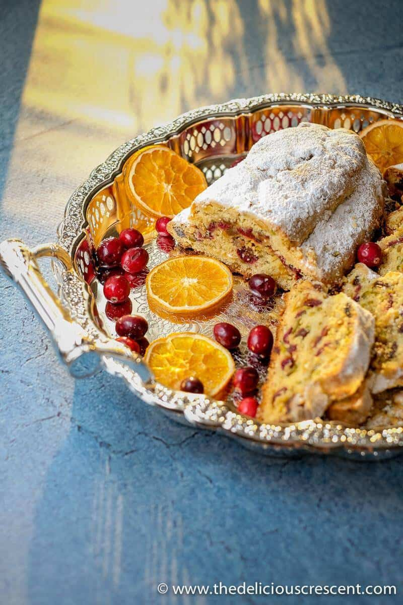 Cranberry Orange Quark Stollen with slices in a serving platter.