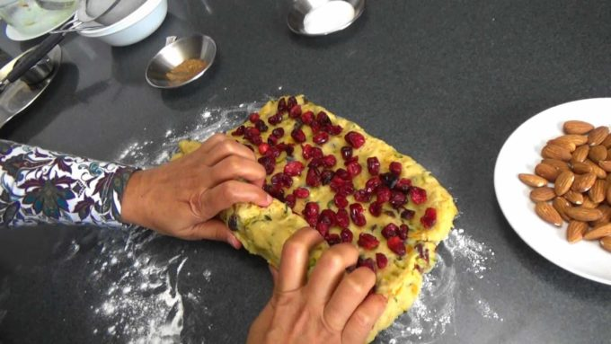 Rolling the dough after adding the cranberries to make Cranberry Orange Quark Stollen