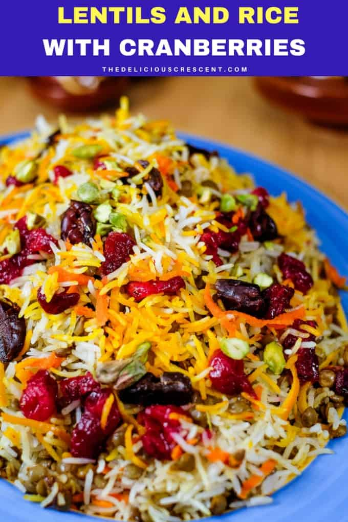 Lentils and rice with cranberries is an aromatic Persian style dish that is a bit tangy, subtly sweet and savory. Easy, healthy and gluten free this flavorful one pot meal is packed with plant protein and fiber. This cranberry rice with spices can be a great thanksgiving side. Vegan option. Ingredient substitutions.  | Lentil Rice | Adas Polo | Persian lentil rice | #vegan #vegetarian #glutenfree #Persian #rice #realfood #recipe