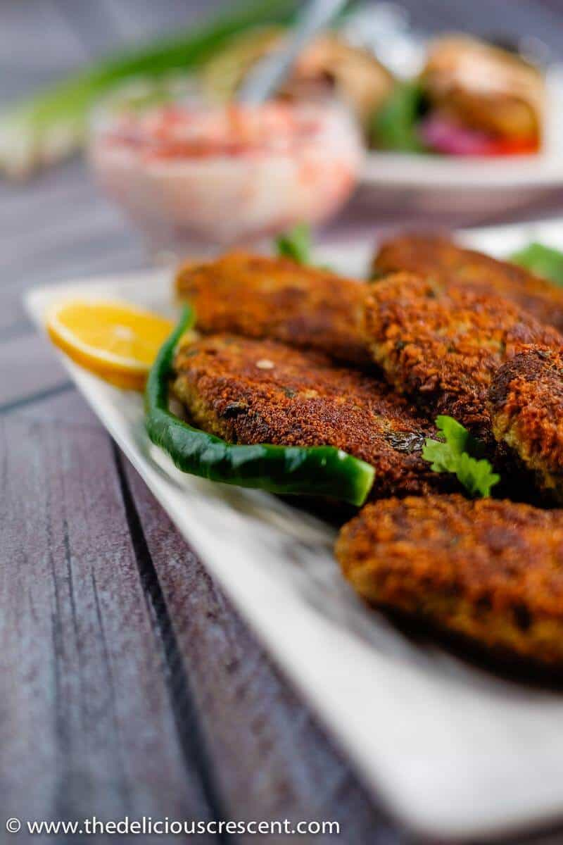 Close up view of fish cakes (shami kabab) served on a plate.